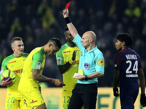 French soccer referee kicks player, then boots him from