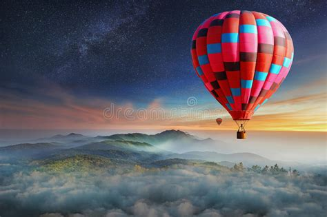 Colorful Hot-air Balloons Flying Over The Mountain With